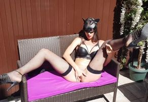 Catwoman jacks outdoors