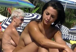 This naturist  nude at the beach..