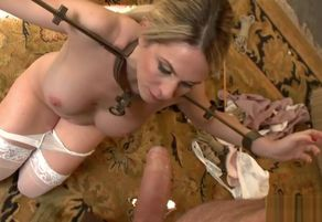 Angela Attison gets strapped up and..